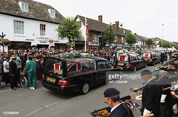 Friends and family gather in Wootton Bassett High Street as the cortege carrying the bodies of four soldiers killed in Afghanistan on July 20, 2010...