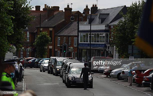 Friends and family gather in Wootton Bassett High Street as the cortege carrying the bodies of four soldiers killed in Afghanistan passes through on...