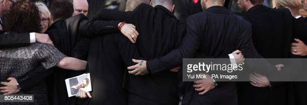 Friends and family including mother Margaret embrace at the funeral of Stephen Gately at St Laurence O'Toole Church in Dublin