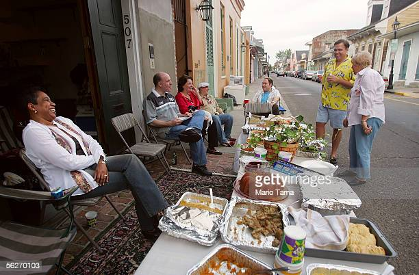 Friends and family join Dereck Terry as he hosts a potluck Thanksgiving dinner in front of his house in the French Quarter November 24, 2005 in New...