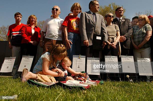 Friends and family members wait to read names of loved ones at 'In Memory Day' which is held to honor those who died as a result of the Vietnam War...