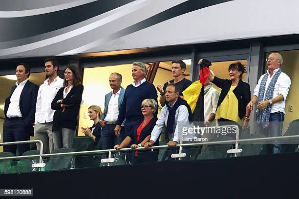 Friends and family of Bastian Schweinsteiger of Germany look on after his last international match during the International Friendly match between...