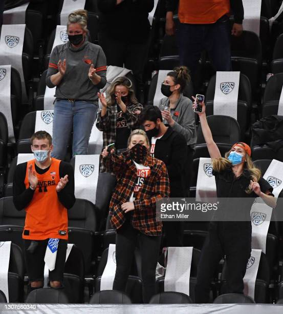 Friends and family of head coach Wayne Tinkle of the Oregon State Beavers, including his son Tres Tinkle and daughters Joslyn Tinkle and Elle Tinkle,...