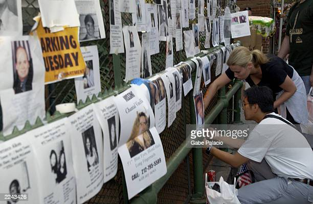 Friends and family of missing people post signs with photos and descriptions to help locate them outside the armory on Lexington Ave in New York City...