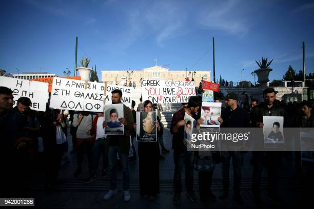 Friends and family of the sixteen refugees that drowned on March 17 near Agathonisi island protest in Syntagma Square in Athens Greece on April 4 2018