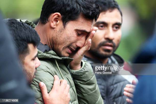 Friends and family of the victims wait near the hospital for news on March 17, 2019 in Christchurch, New Zealand. 50 people are confirmed dead, with...