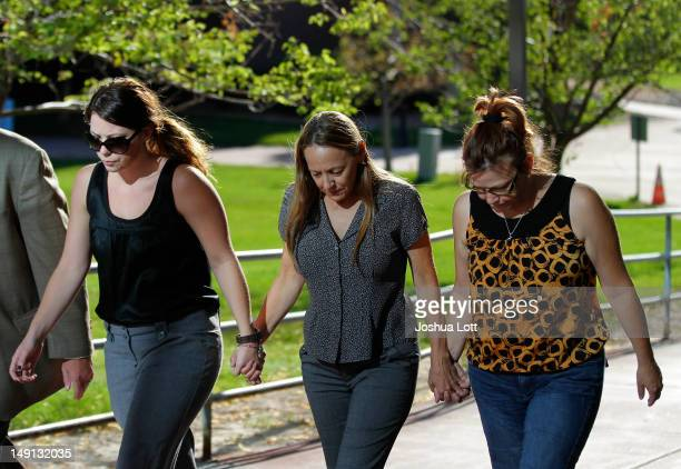 Friends and family of victims of last Friday's movie theater mass shooting arrive at the Arapahoe County Courthouse for suspect James Holmes' first...