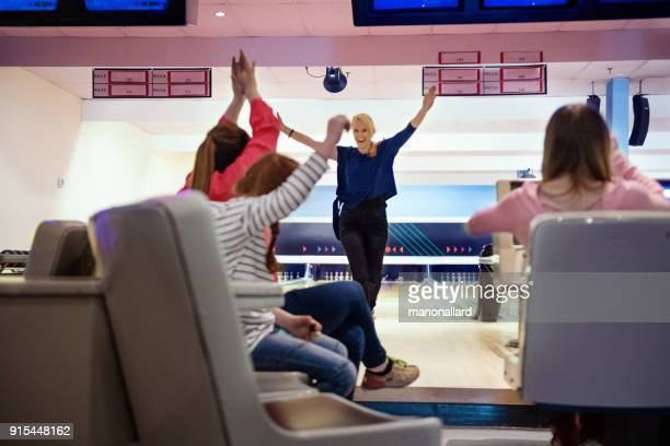 Friends and family play Bowling
