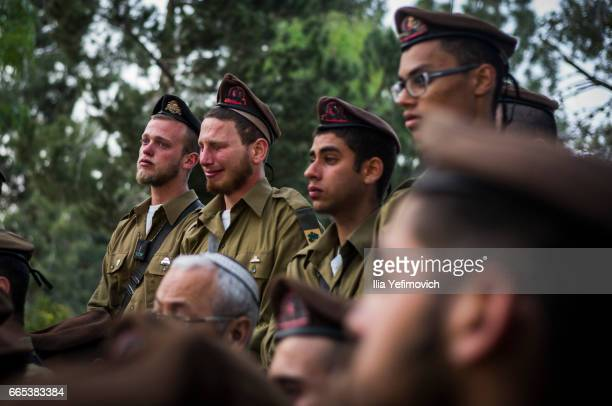 Friends and Family react and mourn at the funeral of Sergeant Elchai Taharlev on April 6 2017 in Jerusalem Israel IDF soldier Sgt Elchai Taharlev was...