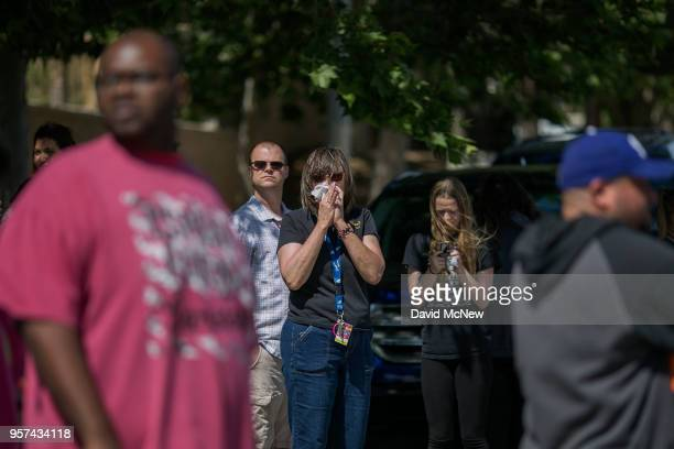 Friends and family wait to be reunited with students after a shooting at Highland High School on May 11 2018 in Palmdale California A 14yearold male...