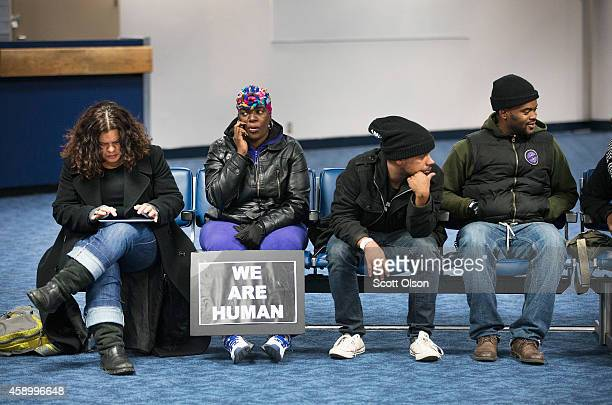 Friends and family wait to greet Michael Browns mother Lesley McSpadden at St Louis International Airport as she travels from Geneva Switzerland...