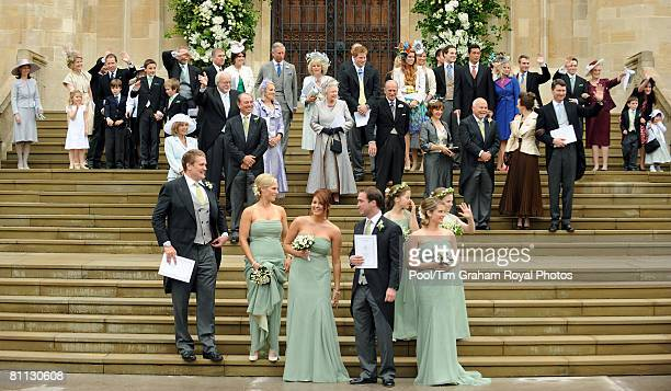 Friends and family wedding guests gather on the steps after the wedding ceremony of Peter Phillips and Autumn Kelly at St George's Chapel in Windsor...