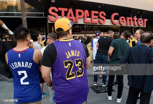 Friends and fans of Kawhi Leonard of the LA Clippers and LeBron James of the Los Angeles Lakers wait in line for the LA Clippers season opening game...