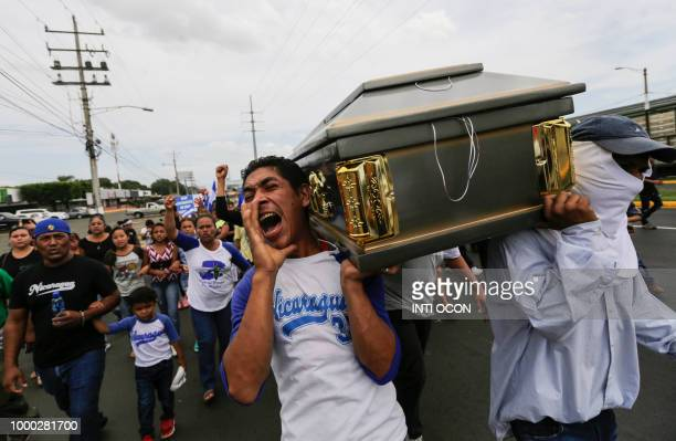 TOPSHOT Friends and relatives carry the coffin containing the body of the student Gerald Velazquez shot dead during clashes with riot police in a...