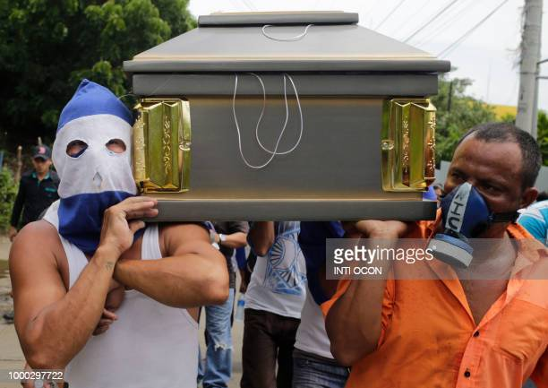 Friends and relatives carry the coffin containing the body of the student Gerald Velazquez shot dead during clashes with riot police in a church near...