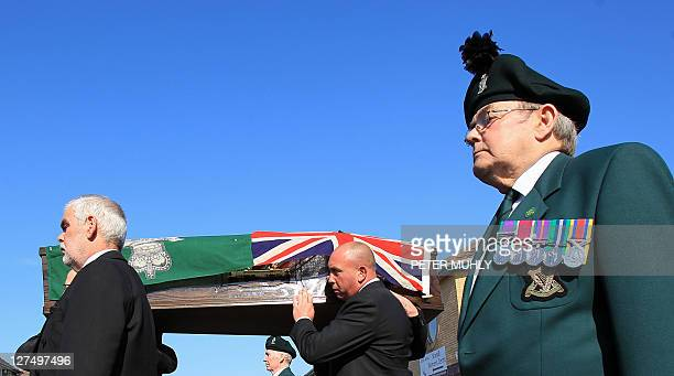 Friends and relatives carry the coffin containing the remains of Gusty Spence following the funeral ceremony at St Michael's Church of Ireland in...