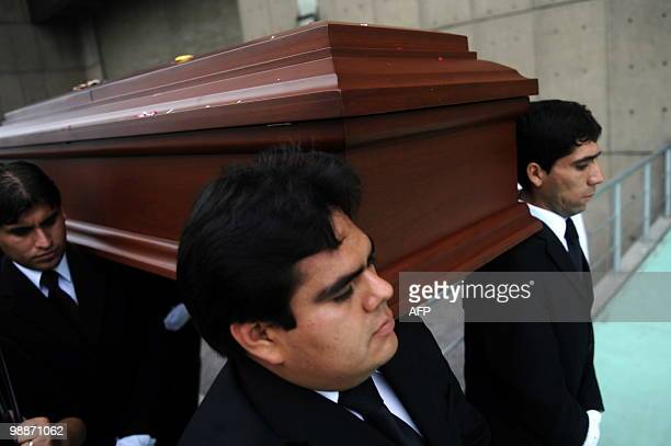 Friends and relatives carry the coffin of Peruvian singer Luis �Lucho� Barrios known as the King of the Bolero who died at 75 after suffering a heart...