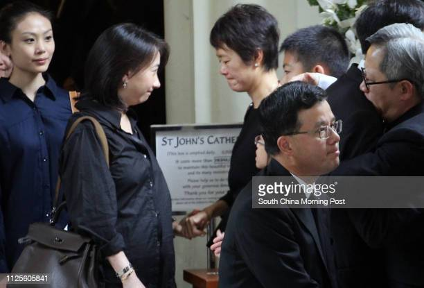 Friends and relatives comfort Emma Liu wife of gastroenterology and haepatology specialist Dr Wayne Hu Hsingcheng who died in a yacht accident at the...