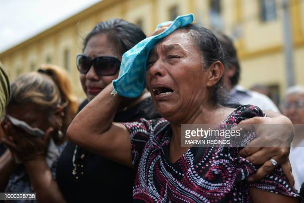 Friends and relatives cry during the funeral of Jose Esteban Sevilla Medina shot dead during clashes with the riot police and paramilitaries at...
