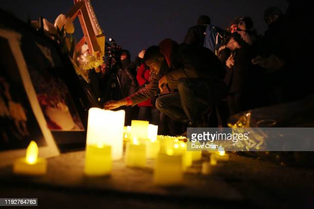 Friends and relatives gather on Parliament Hill during a candle light vigil for the victims who were killed in a plane crash in Iran on January 9...
