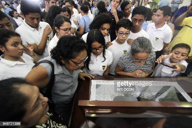 Friends and relatives grieve next to Alvaro Conrado's coffin a high school student killed during a protest against government's reforms in the...