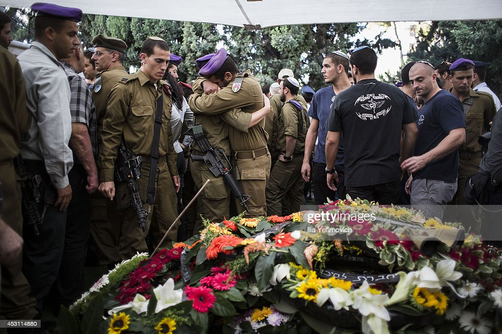Friends and relatives mourn during the funeral for Israeli Lt. Hadar Goldin on August 3, 2014 in Kfar-saba, Israel. Goldin was thought to have been captured during fighting in Gaza, but was later declared killed in action by the Israeli Defence Force (IDF).