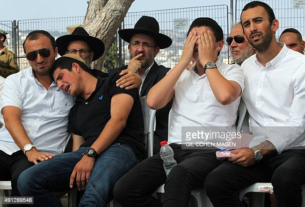 Friends and relatives mourn during the funeral of 24yearold IsraeliCanadian soldier Aaron Bennett who was killed when a Palestinian man attacked him...