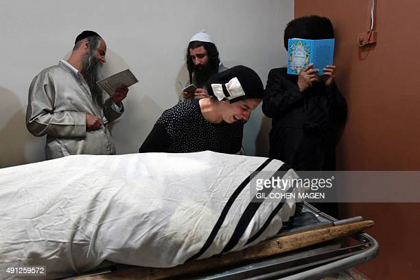 Friends and relatives mourn over the body of 24yearold IsraeliCanadian soldier Aaron Bennett who was killed when a Palestinian man attacked him and...