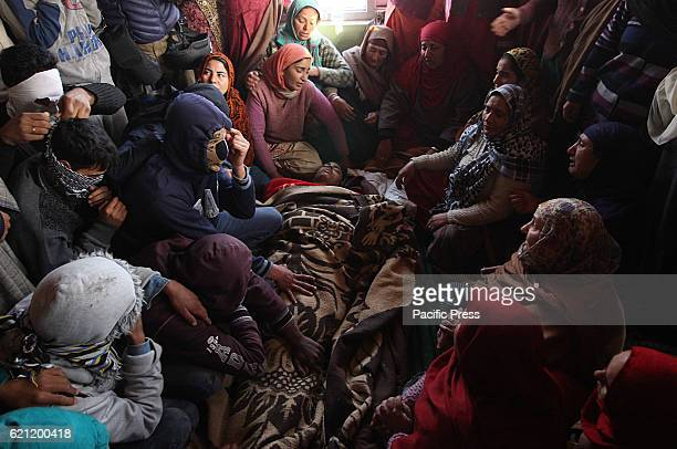 Friends and relatives of 16 yr old Kaiser Ahmad wail near the dead body in Srinagar the summer capital of Indian controlled Kashmir Kaiser according...