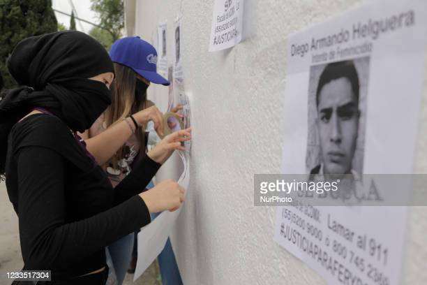 Friends and relatives of Fer and Polly, young victims of attempted feminicide by Diego Helguera last weekend, paste photographs of the accused...
