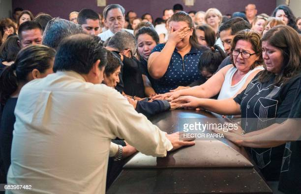 TOPSHOT Friends and relatives of Mexican journalist Javier Valdez grieve as his coffin arrives in Culiacan Sinaloa State Mexico on May 16 2017 Valdez...