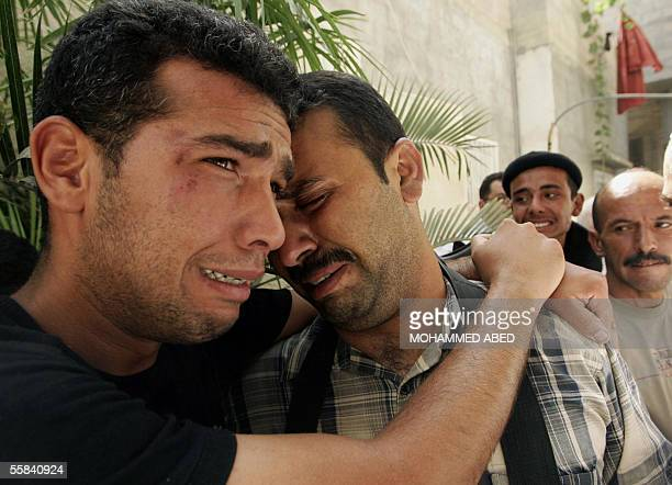 Friends and relatives of Palestinian police Major Ali Makawi mourn during his funeral in Gaza city 03 October 2005 Makawi was killed while more than...