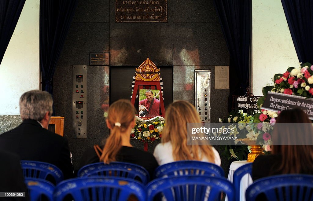 Friends and relatives of slain Italian photograher Fabio Polenghi pays their respects at his funeral at a temple in Bangkok on May 24, 2010. Polenghi, a freelance photographer and documentary maker, was shot while covering the military offensive to close down long-running 'Red Shirts' demonstrations in the capital on May 19.