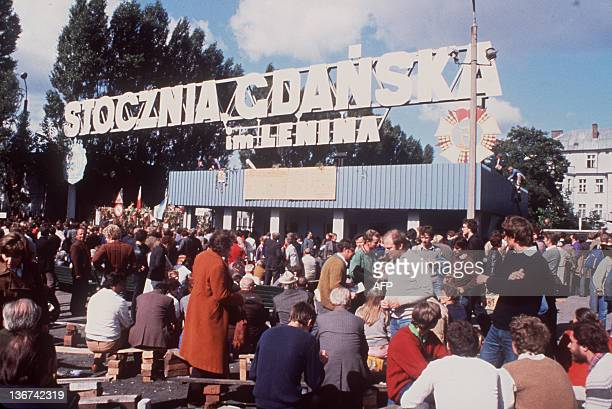 Friends and relatives of striking workers wait for news outside the gates of the Lenin Shipyard in Gdansk, 25 August 1980. The strike in the Gdansk'...
