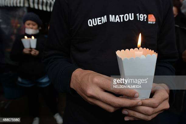 Friends and relatives of victims of a series of murders occurred in Osasco and Barueri hold a protest demanding for justice on September 13, 2015 in...
