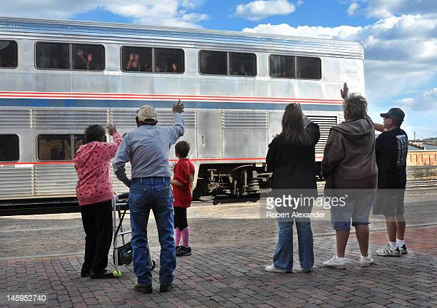 Friends and relatives wave goodbye to passengers aboard Amtrak's Southwest Chief as the train leaves the Amtrak depot in Las Vegas New Mexico The...