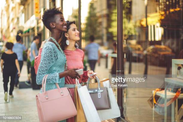 friends are window shopping in the summer - merchandise stock pictures, royalty-free photos & images