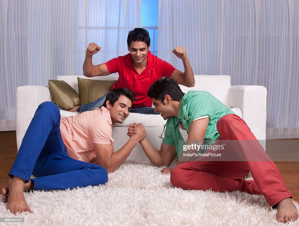 Friends arm wrestling : Stock Photo