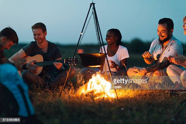 friends around the campfire - campfire stock pictures, royalty-free photos & images