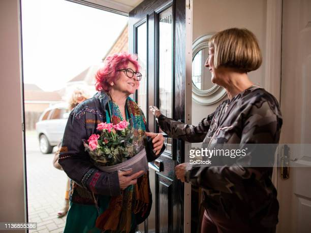 friends arriving for a dinner party - guest stock pictures, royalty-free photos & images
