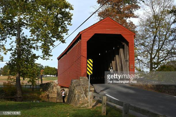 Friends Ashley Baird and Morgan Anderson, both 8 and who live in Westminster, MD explore the Loys Station Covered Bridge October 18, 2020 in Rocky...
