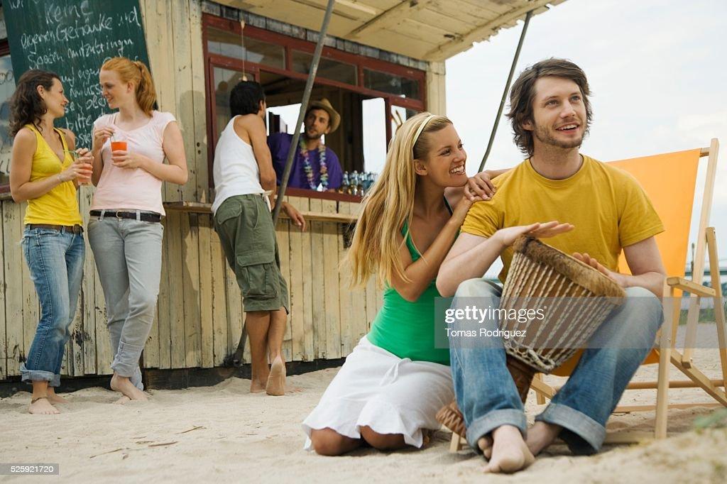 Friends at a Beach Bar : Bildbanksbilder