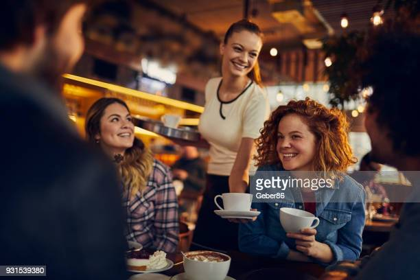 friends at a cafe - waiter stock pictures, royalty-free photos & images