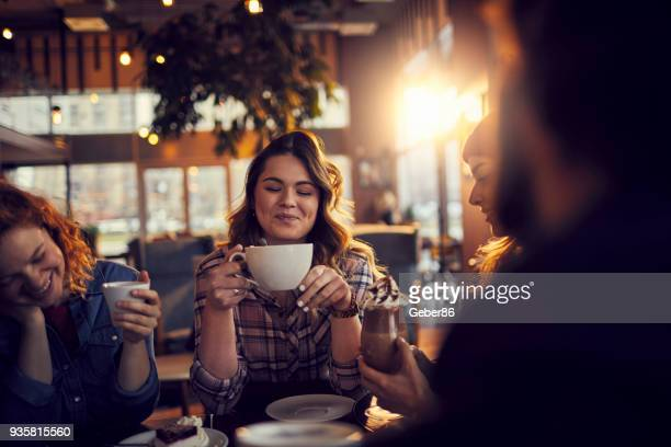 friends at a cafe - coffee stock pictures, royalty-free photos & images