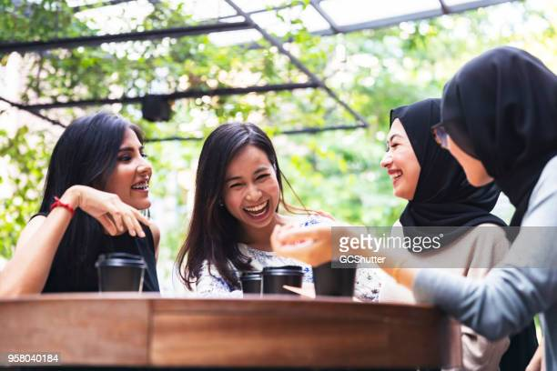 friends at a cafe - malaysian culture stock pictures, royalty-free photos & images