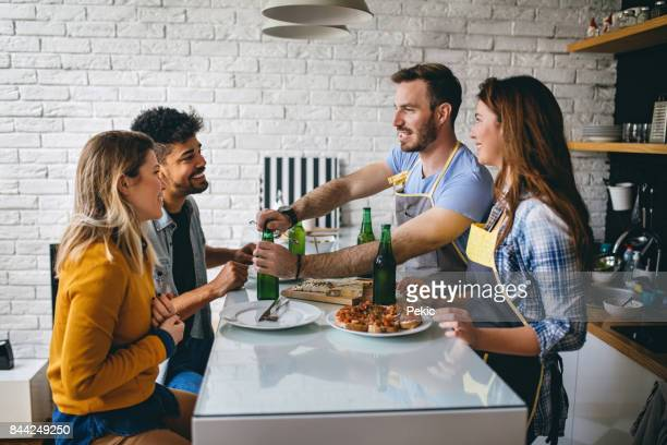 friends at a dinner party - guest stock pictures, royalty-free photos & images