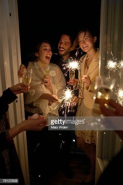friends at a new years party. - brindisi capodanno foto e immagini stock