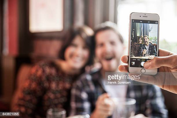 friends at a pub being photographed