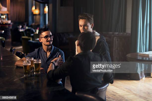 friends at a pub in dublin ireland - irish pub stock photos and pictures