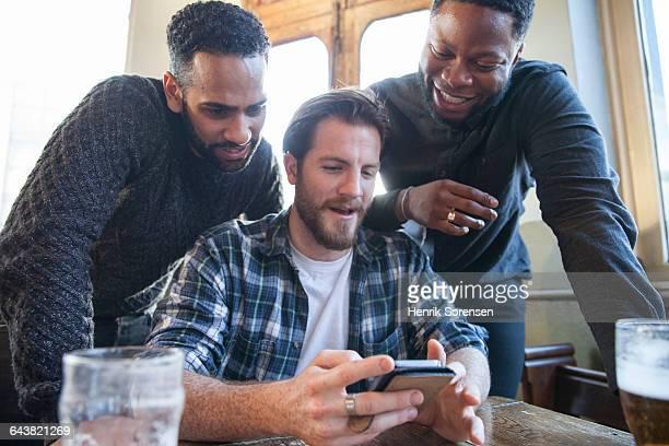 3 friends at a pub
